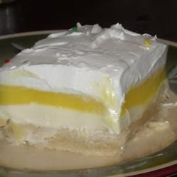 Lemon Lush Recipe - A family friend shared this lemon and cream cheese dessert with me. It has been a hit with our family now for all our get togethers.