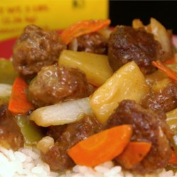 Sweet and Sour Meatballs (Suan T'ien Niu Jou Po Lo La Tzu) Recipe - Beef meatballs, carrot, onion and pineapple pieces simmered in a pineapple sweet and sour sauce. Serve hot over steamed white rice.