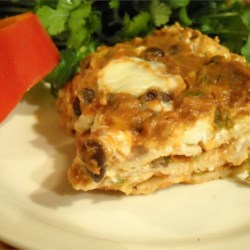 Black Bean Lasagna II Recipe - Lasagna with a Southwest twist. This can be frozen unbaked and kept for up to a month. Simply thaw in refrigerator overnight and bake as directed.  Tastes even better reheated the second day!
