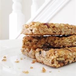 Granola Bars III Recipe - Absolutely delicious! Granola bars with honey, nuts and raisins. These make a great snack!