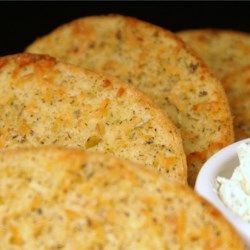 Parmesan Garlic Bread Recipe - Butter and Italian-style spices are blended with Parmesan cheese to make a great spread for warm slices of French bread.