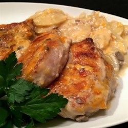 Pork Chop and Potato Casserole Recipe and Video - My family loves this recipe. It is easy and delicious. Pork chops are browned, then baked in a creamy mushroom sauce with potatoes, onion and cheese.