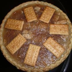 Appleless Apple Pie Recipe - A pie shell is filled with a cooked mixture of sugar, cream of tarter and buttery round crackers.  A sprinkling of butter and cinnamon completes the pie.