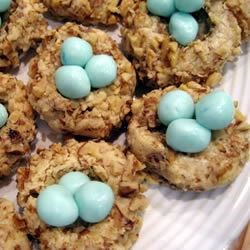 Robin's Nests Recipe - These cute nests are made out of a butter cookie rolled in chopped walnuts. They're filled with homemade fondant eggs.