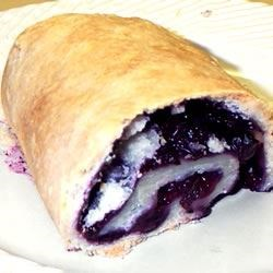Blueberry Pigs Recipe - These little piggies are pie dough rolled up jelly-roll style with blueberries as the filling! Wonderful served warm with milk and sugar.