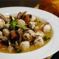 Clams Italiano Recipe - These clams are steamed in wine, butter, and spices. When the clams are gone, dip Italian bread in the broth.