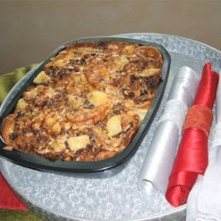 Capirotada (Mexican Bread Pudding) Recipe - This dish was served by my mother every Christmas. It was a big hit! This bead pudding is lovely with the texture of walnuts and the taste of cinnamon. This may be served warm or cold.