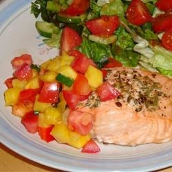 Salmon with Fruit Salsa Recipe - Salmon is baked with lemon and topped with a fruity salsa. Serve over rice.