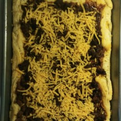 Easy Taco Bake Recipe - Crescent roll dough is topped with refried beans, ground beef, and cheddar cheese creating a quick and easy taco bake for busy weeknights.