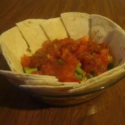 Refried Bean Salad Recipe - There is so much flavor in this tasty bean dip that your guests will never dream that it 's low-fat. Everything is layered into a bowl, so when you 're ready to eat, all you need are some sturdy tortilla chips for deep dipping.
