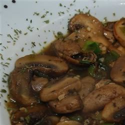 Mushrooms in White Wine Sauce Recipe - Sliced mushrooms are sauteed in peanut oil with onions, garlic, and dried basil, then finished with white wine. It's a great side dish for mushroom lovers.