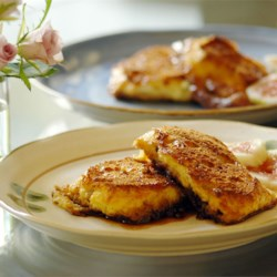 Creme Brulee French Toast Recipe and Video - A rich, puffy outer crust makes this baked French toast recipe well worth the time to prepare it! Use country-style bread, challah, or baguette slices.