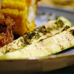 Grilled Zucchini I Recipe - Cut zucchini lengthwise into quarters, season with salt and pepper, and add a pat of butter. Then simply wrap in heavy aluminum foil and grill.