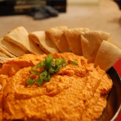 Easy Roasted Red Pepper Hummus Recipe - Everything goes into the food processor  - garbanzo beans, tahini and lemon juice. Then roasted red peppers and basil. Chill and enjoy.