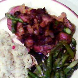 Cranberry Pork Chops I Recipe - Sweet orange marmalade enhances the flavor of the tart cranberries in this wonderful dish.  For a more intense flavor, use 1/4 cup dried cranberries or cherries instead of fresh or frozen cranberries and do not chop.