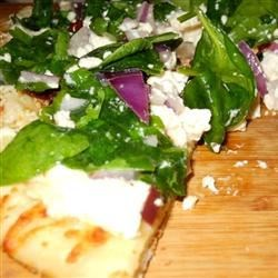 Greek Pizza with Spinach, Feta and Olives Recipe - Sun dried tomatoes, spinach, and Kalamata olives boldly flavor this easy pizza.