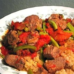 Nita's Lamb, Green Beans and Tomatoes Recipe - Lamb shank and onion is browned in olive oil, then cooked with fresh green beans in a tomato sauce seasoned with mint.