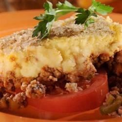 Chilean Potato Pie (Pastel de Papas) Recipe - Ground beef, mashed potatoes, tomatoes, and Chilean cheese are combined to create this Latin American comfort food.