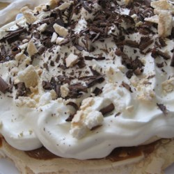 Banoffee Pavlova Recipe - A baked meringue is topped with banana slices, caramel sauce and whipped cream. This is a delicious combination of two very yummy desserts making one that will have you making it over and over again!!!