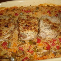 Pork Chops with Garden Rice Recipe - This is my favorite pork chop recipe. The rice is both colorful and flavorful, and the chops are so tender that they fall off the bone.