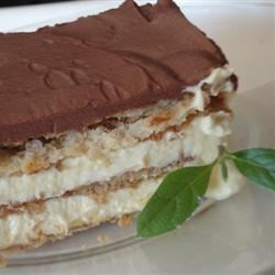 Chocolate Eclair Cake Recipe - Chocolate graham crackers layered between creamy vanilla custard, topped with chocolate glaze. Satisfy your sweet tooth with this quick and easy dessert.