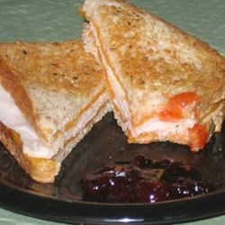 Sweet and Spicy Turkey Sandwich Recipe - This grilled turkey sandwich combines the heat of pepperjack cheese and the sweetness of strawberry preserves for a quick and tasty lunch. Try it with a Black Forest-type turkey for a nice smoky flavor.