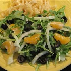 Arugula, Fennel, and Orange Salad Recipe - A honey-and-lemon-juice dressing is drizzled over arugula, fennel, oranges, and olives in this tasty salad recipe.