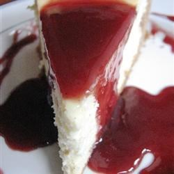 Vanilla Bean Cheesecake Recipe - Three whole scraped vanilla beans give this glorious, rich cheesecake telltale black specks of tropical flavor. This makes a big batch, so you might have enough to make some mini cheesecakes too.