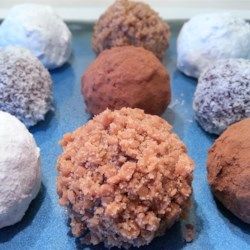 Brandy or Rum Balls Recipe - This is an excellent dessert to bring for the Holidays.  You can use either Brandy or Rum.  These do need some time to set up so it is best to make them the night before. If you don't care for walnuts, the balls can be rolled in confectioners' sugar or cocoa powder.