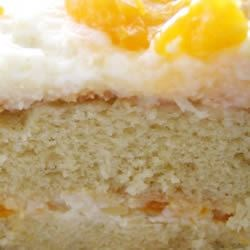 Mandarin Orange Cake I Recipe - Start with yellow cake mix and Mandarin oranges to make this cake with a frosting made with pineapple, pudding mixture, and whipped topping.