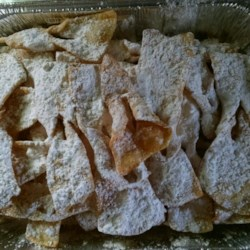 Kruschicki Recipe - This recipe is from my grandmother: the secret is to roll the dough thin for a light, crisp cookie.  Polish bow tie cookies.