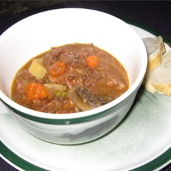 Slow Cooker Beef Stew III Recipe - Carrots, potatoes, mushrooms, onions, and celery are cooked along with the meat in a mixture of dried onion soup mix and condensed golden mushroom soup.