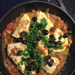 Mediterranean Chicken Recipe - The lightness of white wine contrasts with plenty of garlic, onion and herbed tomatoes in this simmered chicken dish highlighted with the piquancy of Kalamata olives.