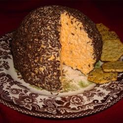 Caraway Cheese Ball Recipe - The caraway seeds add a nutty, rustic flavor that complements the sharp tang of the Cheddar cheese.