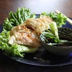 Gyoza Recipe - These Japanese pot stickers are a fun favorite! Little fried wrappers are filled with pork and veggies, and dipped into a tasty sauce.