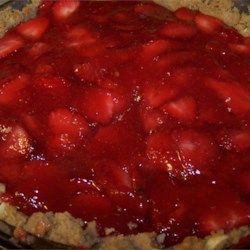 Fresh Strawberry Almond Pie Recipe - It 's a toss up which is more delicious, the filling or the crust on this amazing pie. The crust is made from crushed shortbread cookies and almonds, and the filling is fresh strawberries smothered in a strawberry glaze. And the whole thing is topped with freshly whipped cream.