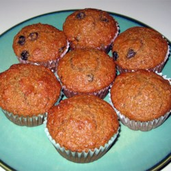 Honey Bran Muffins Recipe - Pineapple juice and golden raisins add a fruity sweetness to these bran muffins made with shredded wheat-bran cereal, honey and brown sugar.  Since you must refrigerate the batter, mix it up at night so you can bake them up fresh for breakfast in the morning.