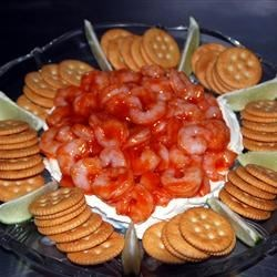 Heavenly Shrimp Dip Recipe - A squeeze of fresh lime juice brightens the flavors in this cream cheese, cocktail sauce and shrimp spread.  Serve with crackers.