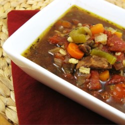 Beef Barley Vegetable Soup Recipe - A chuck roast is cooked with barley and bay leaf in a slow cooker before it is cubed and added to a soup pot of simmering vegetables in a beef broth.