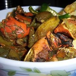 Spicy Crab Curry - Bangla Style Recipe - Fresh crab meets flavors from the Subcontinent: it's spiced with red and green chiles, mustard oil, mustard paste, potatoes, and onions.