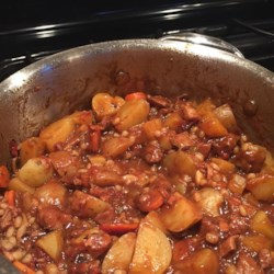 JG's Irish Lamb Stew Recipe - Tender chunks of lamb simmer for hours with pearl barley, potatoes, and rutabaga in a traditional Irish stew flavored with dark stout beer.