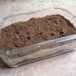 Ice Box Cake II Recipe - Graham cracker crumbs, whipping cream, marshmallows, bananas, nuts, and crushed pineapple make up this easy no-bake dessert.