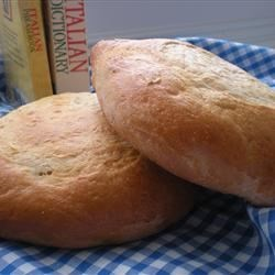 Italian Bread Baked on a Pizza Stone Recipe - Mixed in the bread machine, this easy yeast bread with olive oil and a dusting of cornmeal is baked on a pizza stone.