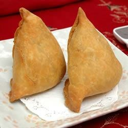 Yogurt Samosas Recipe - Cilantro and yogurt give these samosas the Indian flavor. This is an amazing recipe that will surprise you with how easy it is to make samosas like an Indian restaurant.
