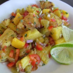 Grilled Pineapple Mango Salsa Recipe - This salsa is easy to make and tastes as fresh as summer with the inclusion of mango, pineapple, red bell pepper, jalapeno pepper, and lime.