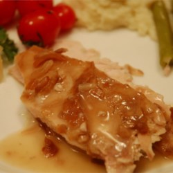 Slow Cooker Turkey Breast Recipe - Quick and easy way to cook turkey in the slow cooker. With only two ingredients, the only hard part is waiting.