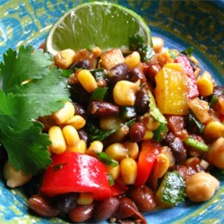 Bean Salad Recipe - A spicy bean salad with a kick of lime that is great as a side dish, nacho topping, or all on its own!