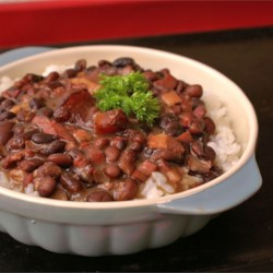 Feijoada (Brazilian Black Bean Stew) Recipe - My version of a traditional Brazilian dish that I 'tweaked' to reduce fat while keeping the rich flavors famous in Brazil....my Brazilian friends gave this version rave reviews!  Additional meats, including sausage, may be added if desired. This is excellent served over brown rice.