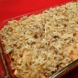 Cajun Cake Recipe - A homemade pineapple cake is topped with a caramel-pecan sauce that soaks into the cake.