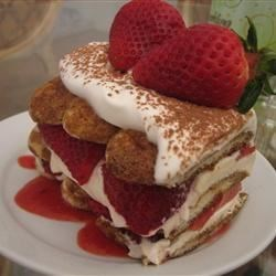 Strawberry Tiramisu for Two Recipe - Strawberries add bright notes of taste and color to this multi-layered treat. Spongy ladyfingers, brushed with espresso, are blanketed with a creamy mix of mascarpone cheese, coffee liqueur and strawberries, and set into a pool of strawberry puree.